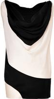 Donna Karan Top noir/crème une épaule